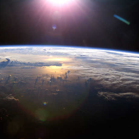Sun over Earth from the ISS, 2013; NASA