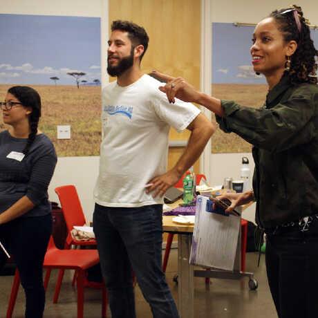 3 educators in Academy classroom