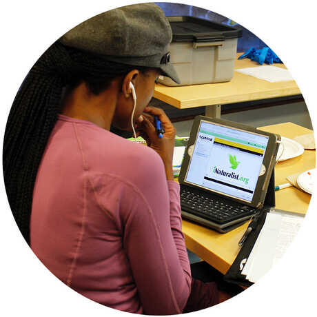 SAC educator in a virtual training with her laptop