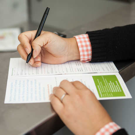 A person filling out a form