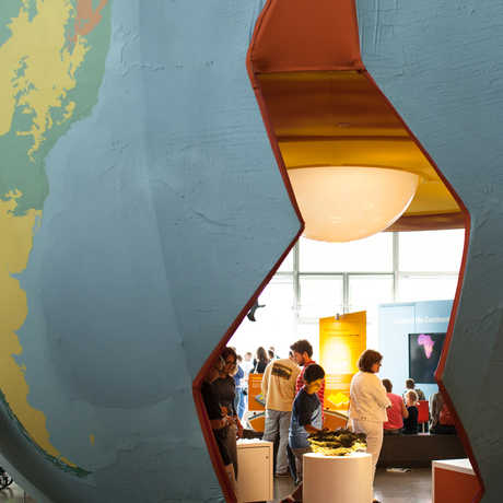 A giant recreation of our planet allows visitors to wander inside and explore the core.