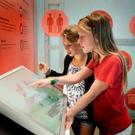 Young visitors explore the Earthquke exhibit at California Academy of the Sciences.