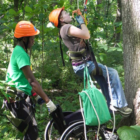 A student is being lifted into the canopy.