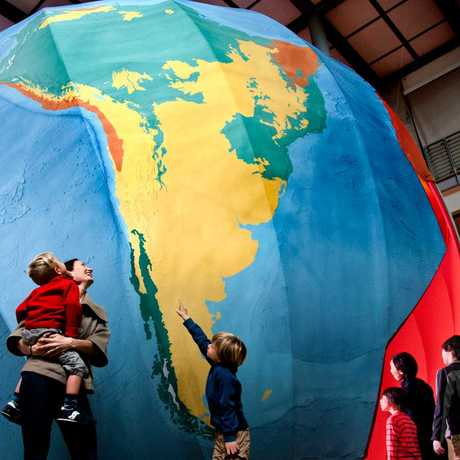 A family investigates a giant scale model of planet Earth in our Earthquake exhibit.