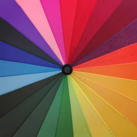 Top view of a rainbow colored umbrella