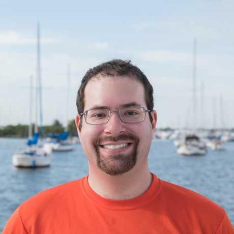 Dr. David Shiffman in front of a marina