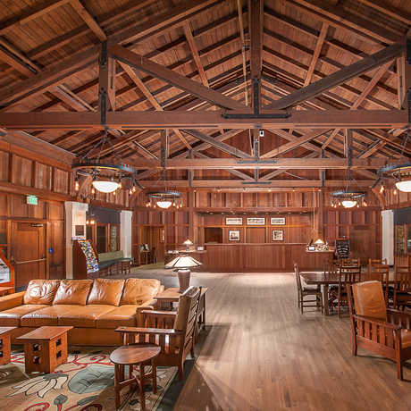 The rich wood interior of Asilomar's social hall