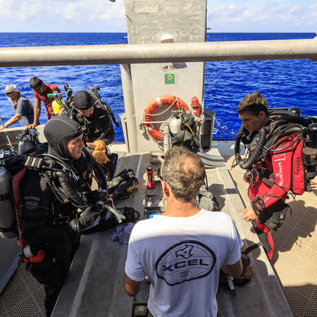 Scientific divers aboard a dive boat in the Marshall Islands