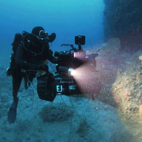 Dive safety officer Elliott Jessup films 250 feet below
