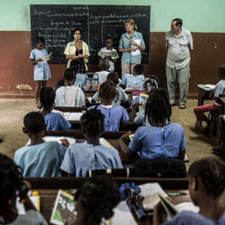 The Academy team addresses a classroom of local kids