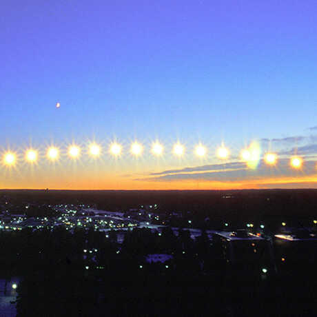 Time-lapse photo of sun moving across horizon