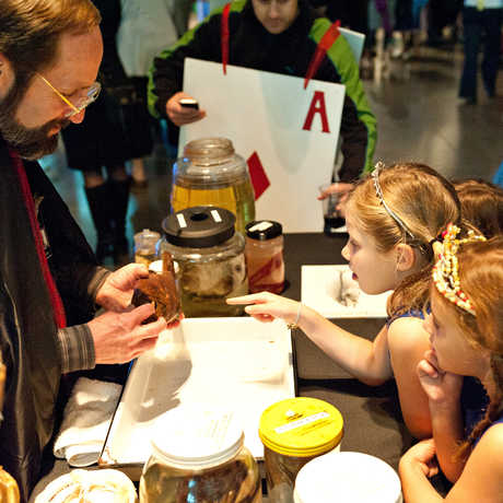 Children in costume with specimens