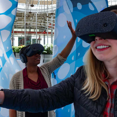 Guests in virtual reality headsets exploring Drop in the Ocean