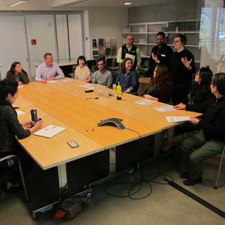 A Staff Advisory Council meeting in an Academy board room