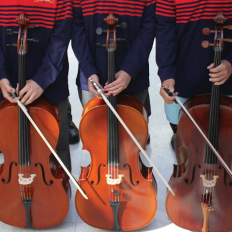 Three musicians and their cellos.