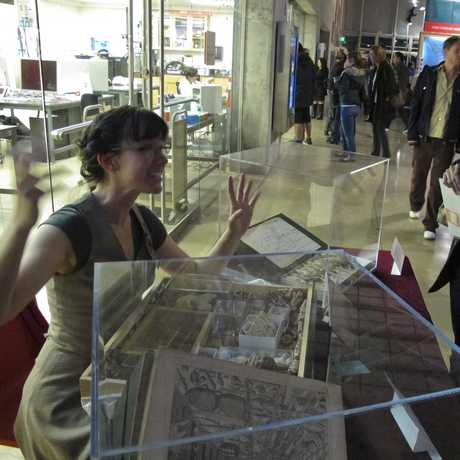 """Stephanie Stewart-Bailey interacts with visitors at the Academys """"Crafty"""" Nightlife event."""
