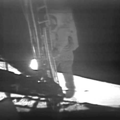 Neil Armstrong stepping foot on the Moon