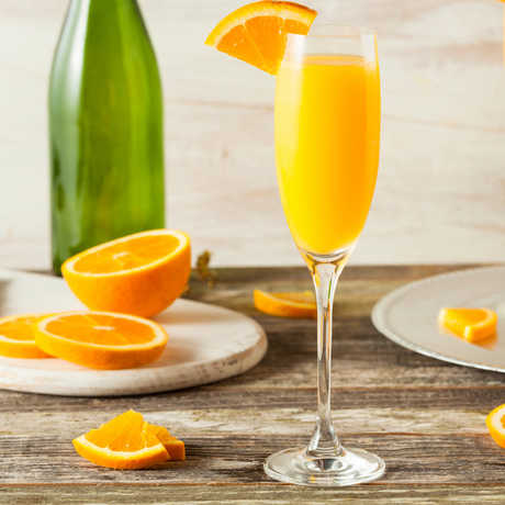 Mimosas and orange slices on a table