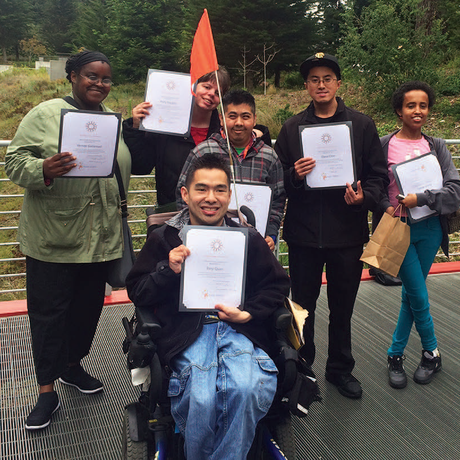 Proud graduates of the Academy ARC program pose with their diplomas