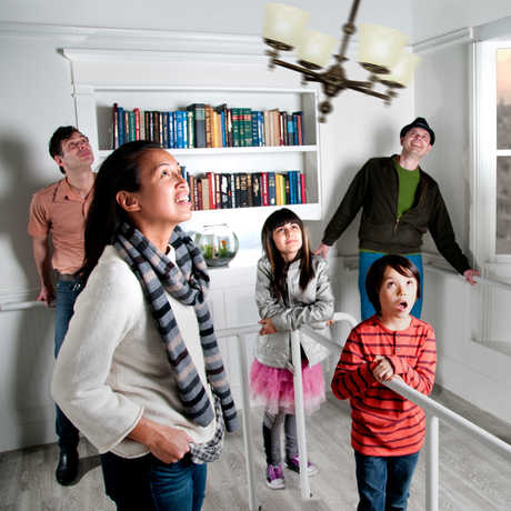 """Visitors inside the """"Shake House"""" feel the floor shake as chandeliers sway."""