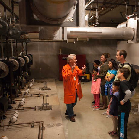 A docent explains the Academy's engineering marvels to a group of members