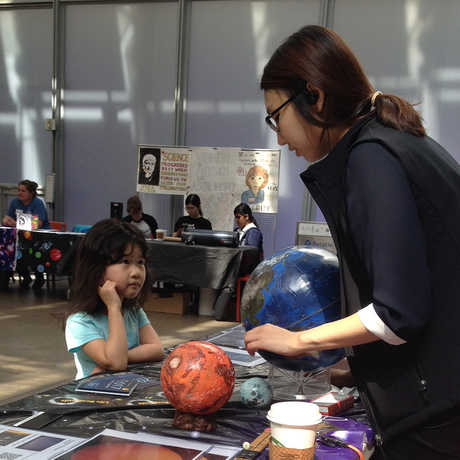A young visitor learns about planets