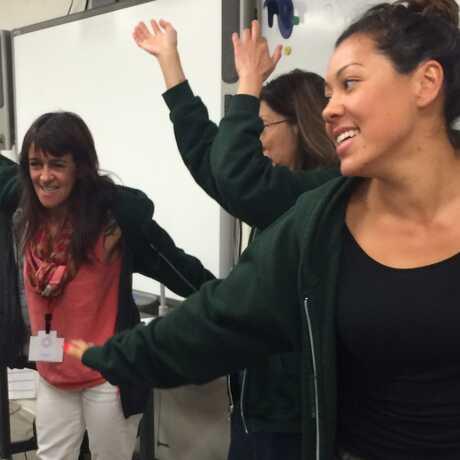 teachers mingle during an icebreaker