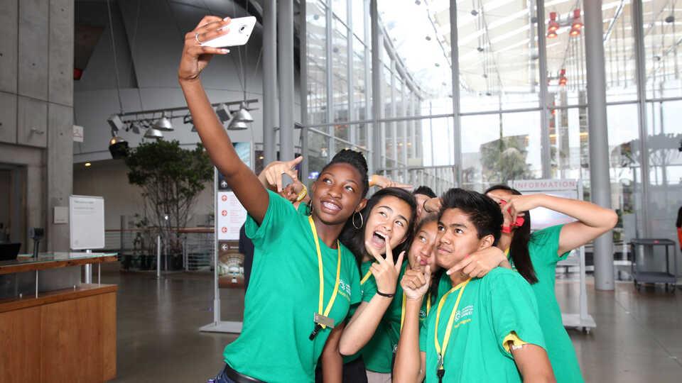 Youth Program Teens taking a Group Selfie