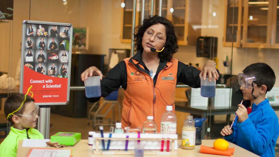 Presenter explaining ocean acidification