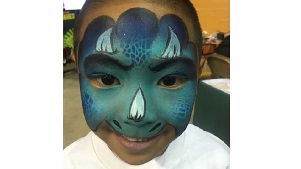 Child in Dinosaur face paint