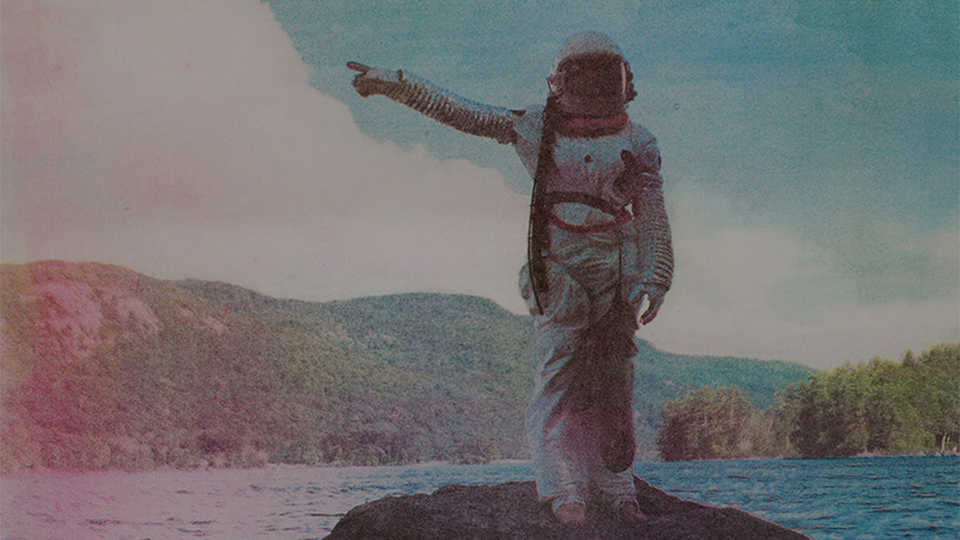 Illustration of astronaut in space suit standing in a lake