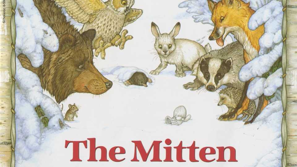 Animals on a storybook cover looking at a white mitten