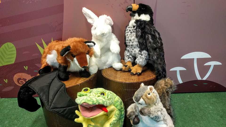A group of animal puppets including a squirrel, frog, rabbit, falcon, and fox.